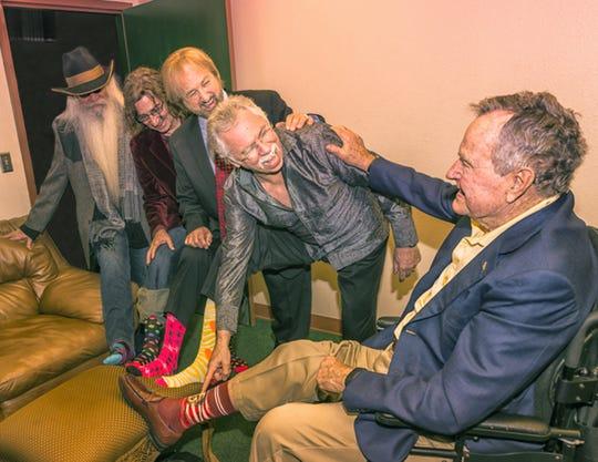 The Oak Ridge Boys compare colourful socks with worn President George H. W. Bush.